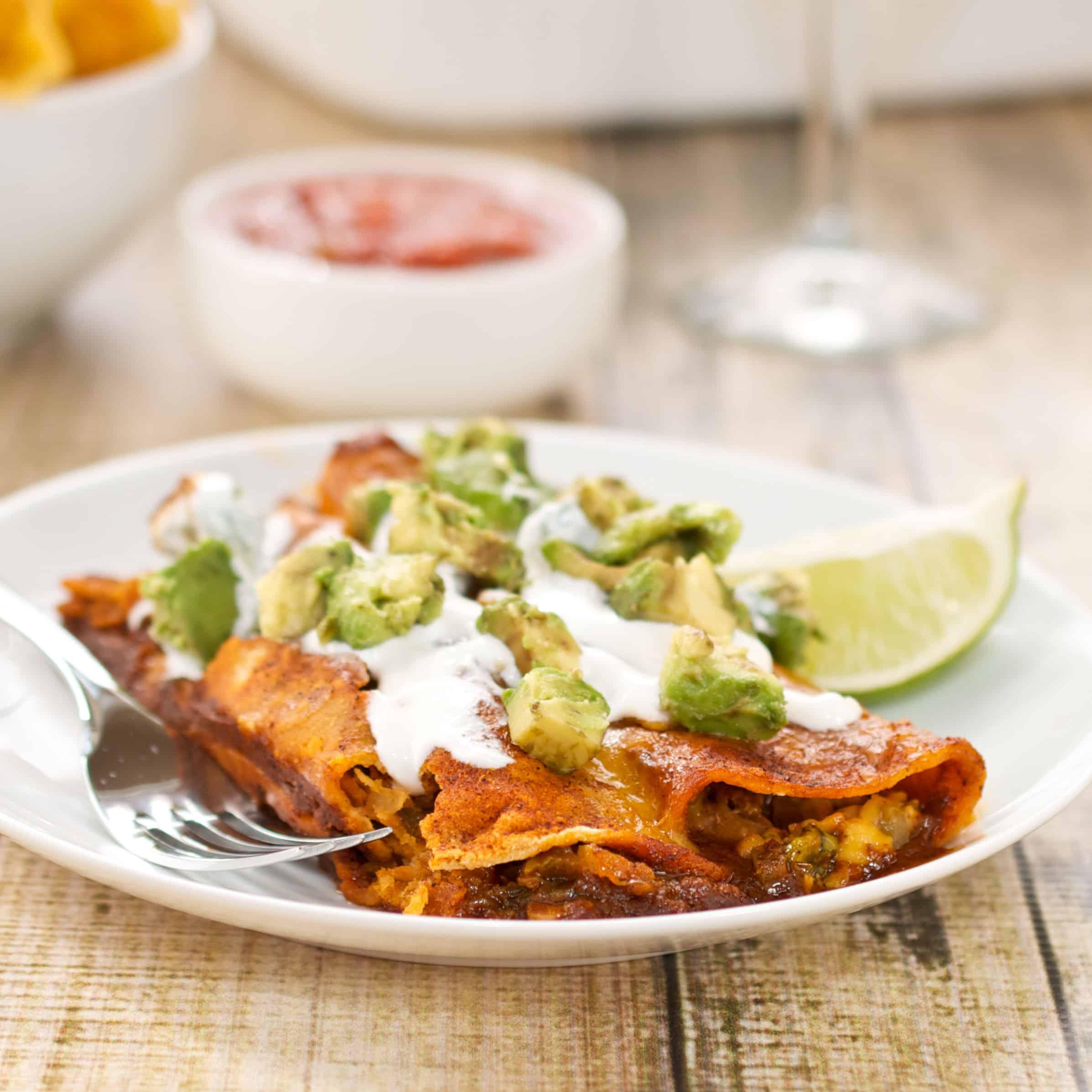 easy chicken enchilada on a white plate
