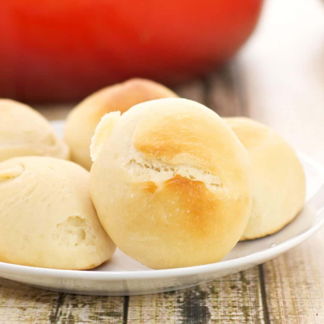 fluffy dinner rolls on a plate
