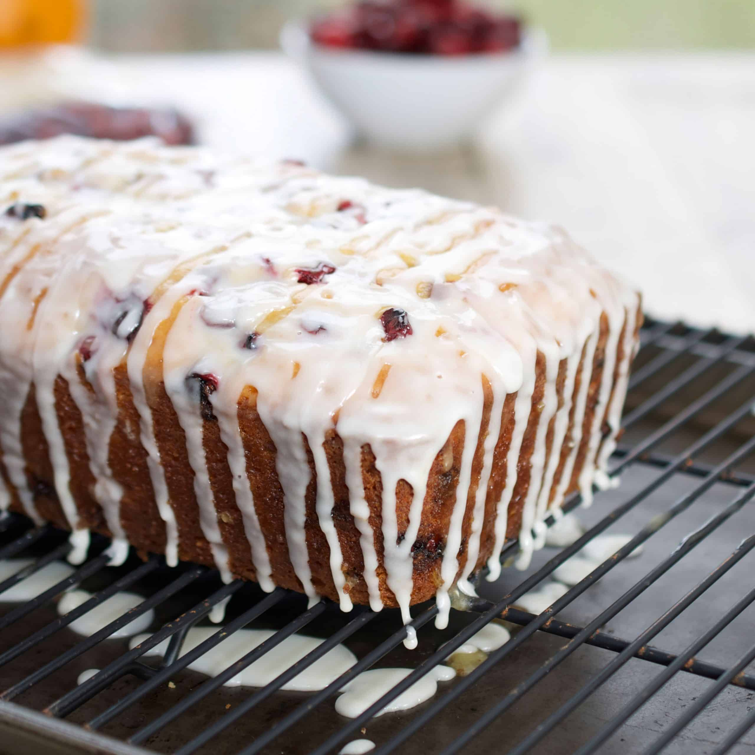 Cranberry Orange Bread with Simple Glaze on a cooling rack
