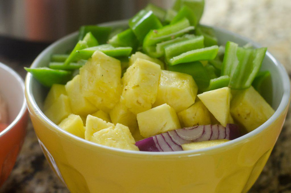 veggies and fruit in a yellow bowl