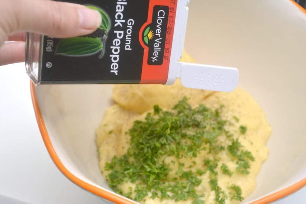 adding pepper into a bowl