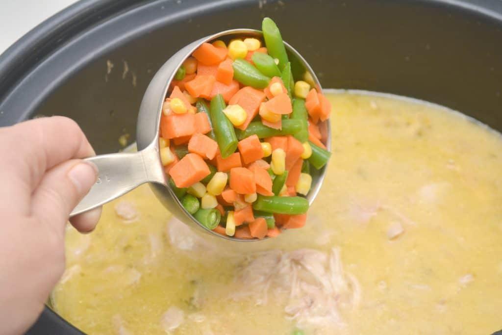 adding vegetables in crockpot