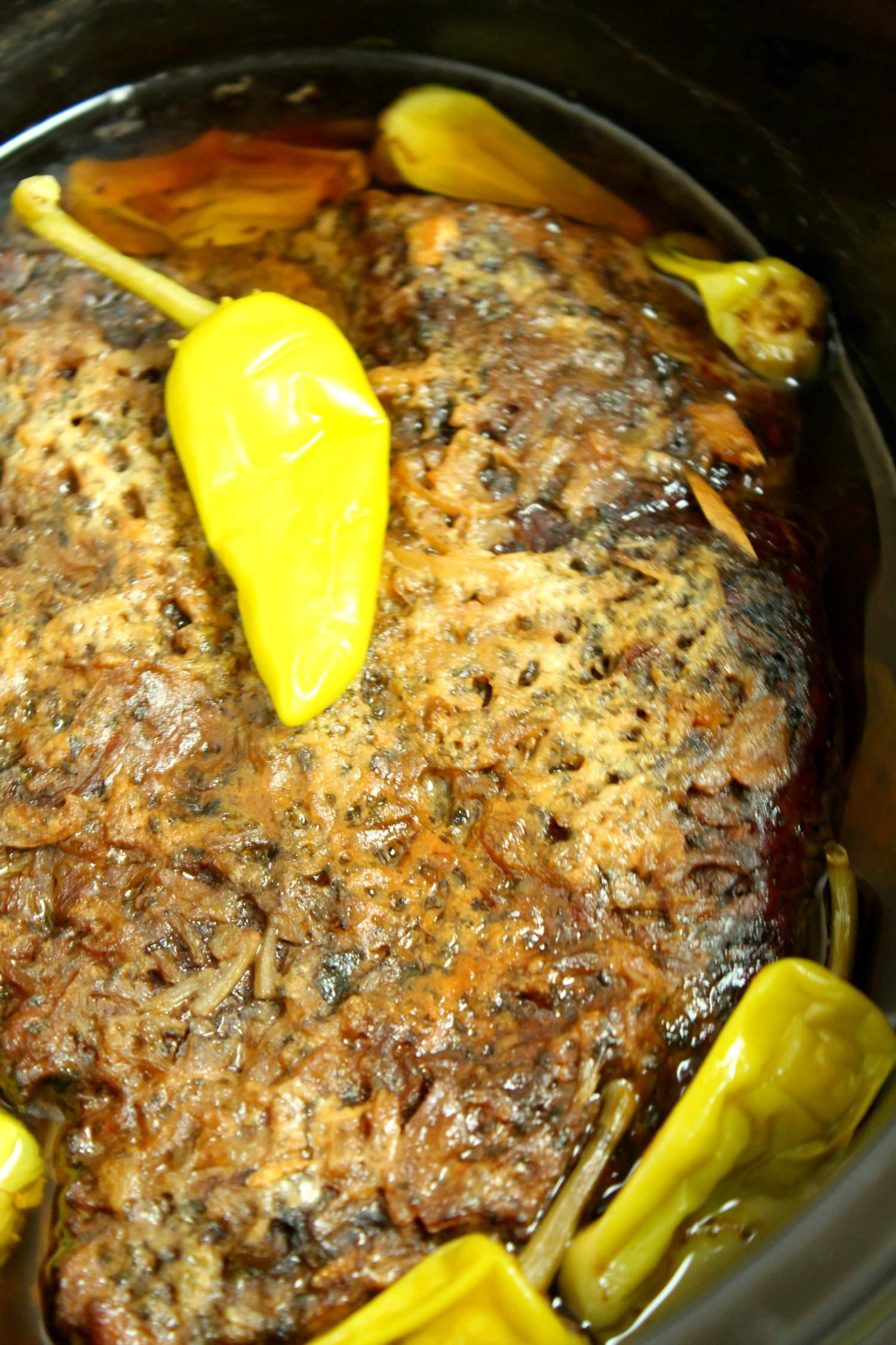 a seasoned pot roast in slow cooker