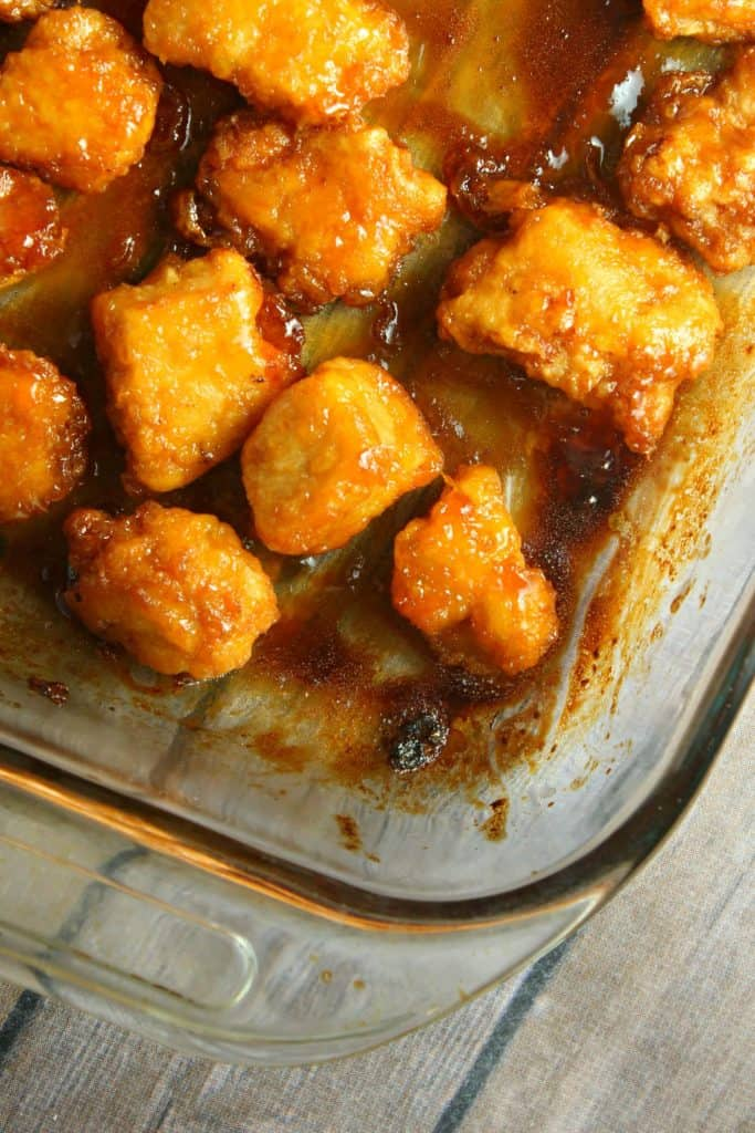 Baked Sweet and Sour Chicken in a pan on table