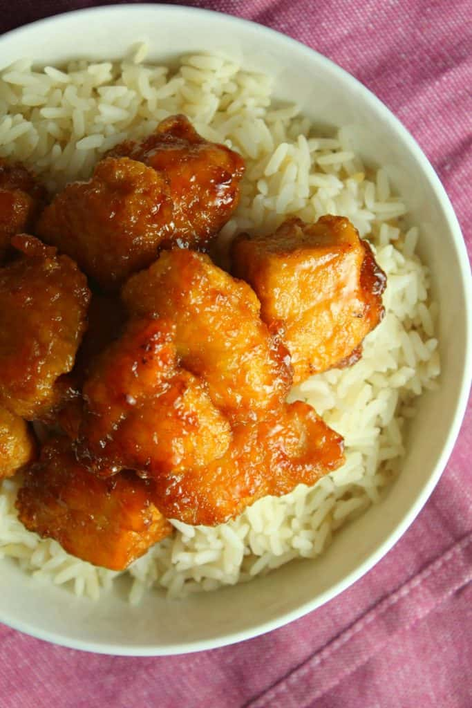 Baked Sweet and Sour Chicken in a bowl of rice on table