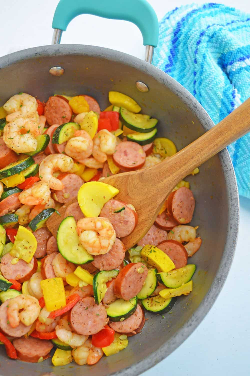 shrimp and sausage skillet with spoon in it