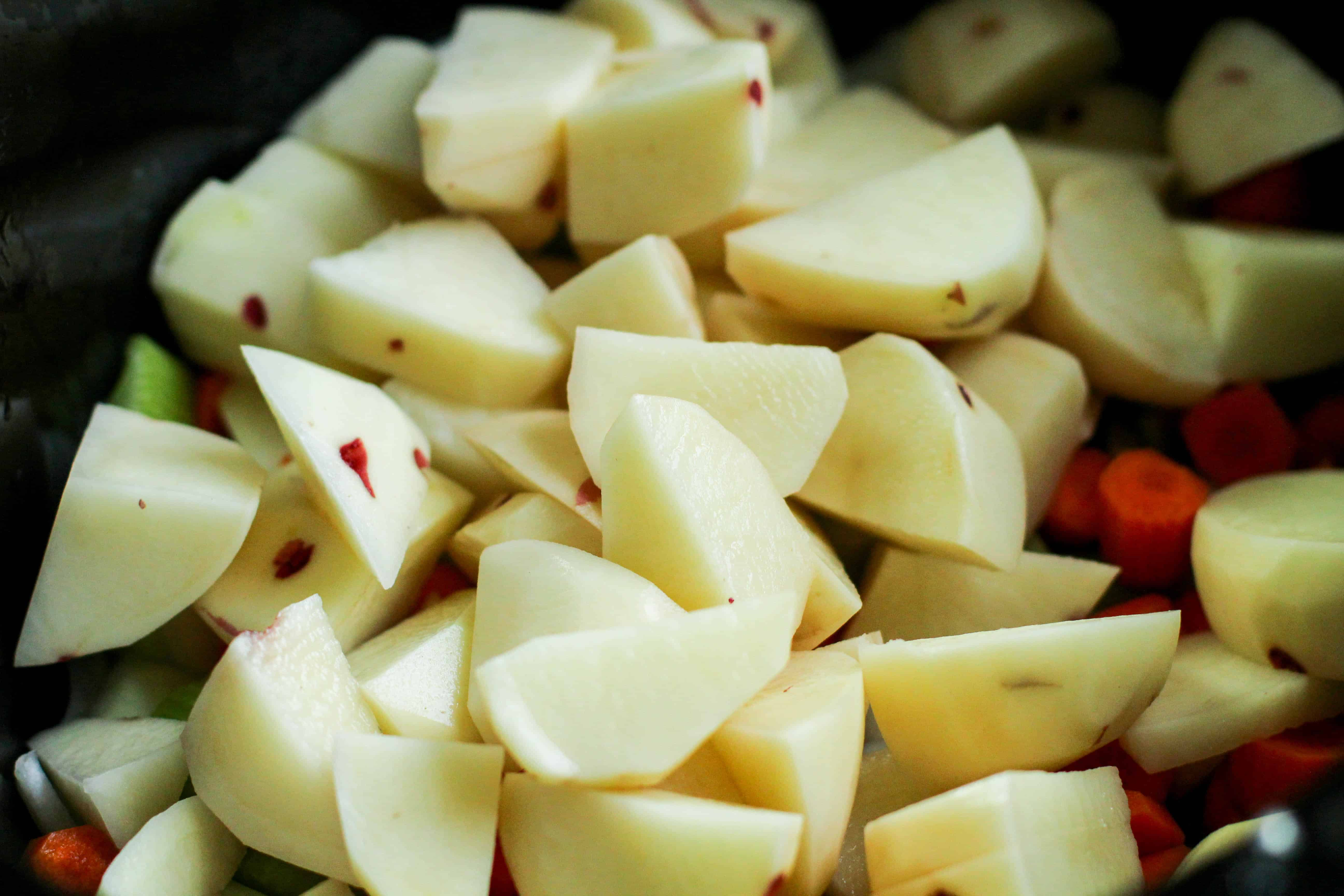 peeled potatoes in a bowl