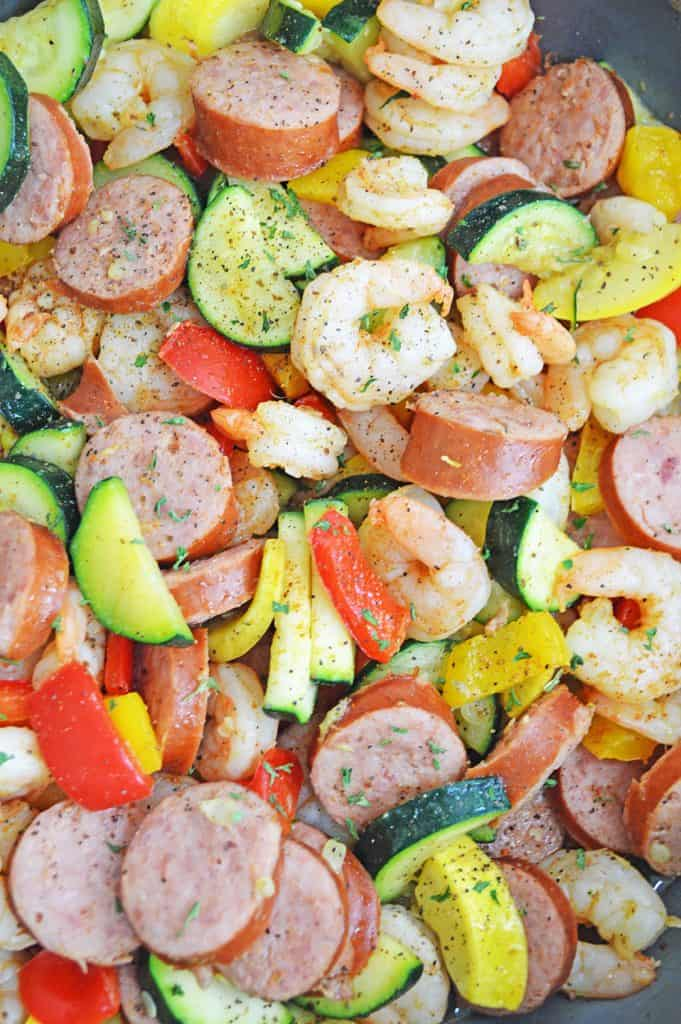 shrimp and sausage recipe in a pan with seasoning on top
