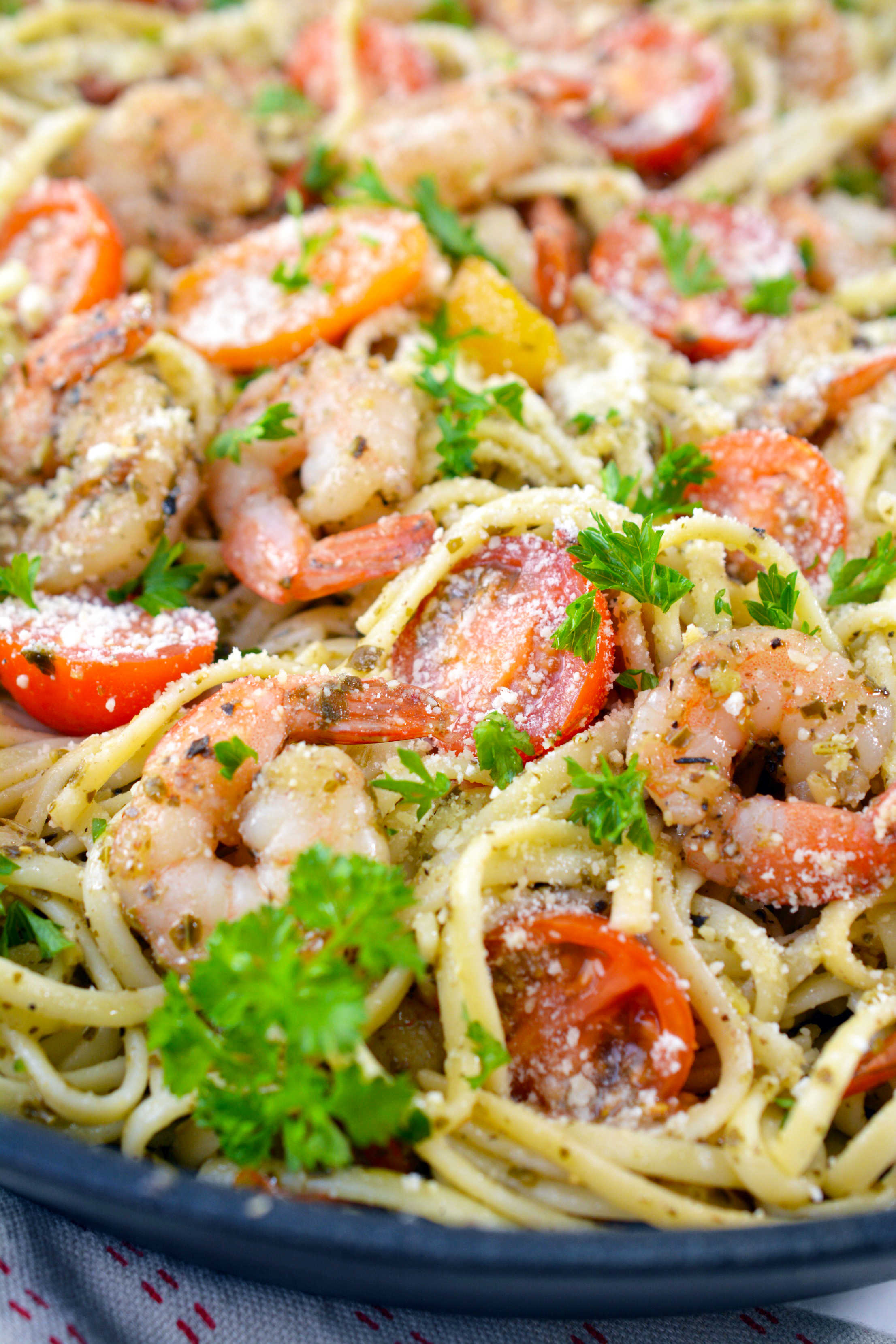 Shrimp Pesto Pasta in a pan with close up image