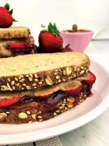 almond buttter and jam sandwich on plate