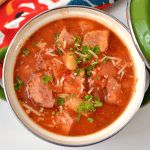 Overhead picture of instant pot sausage and bean soup in a small crock for serving
