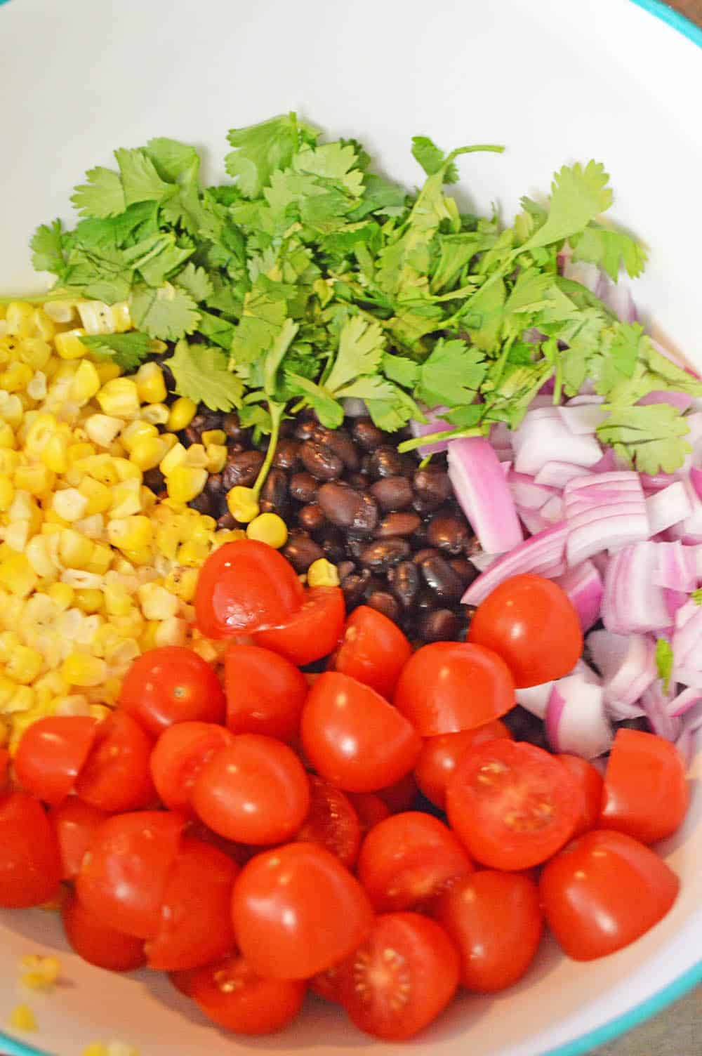 black bean and corn salad prepped in a bowl