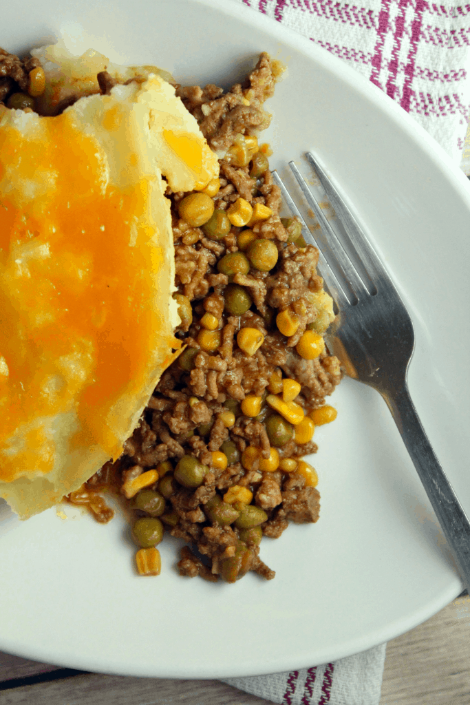 overview of ground beef sheperd pie on a plate