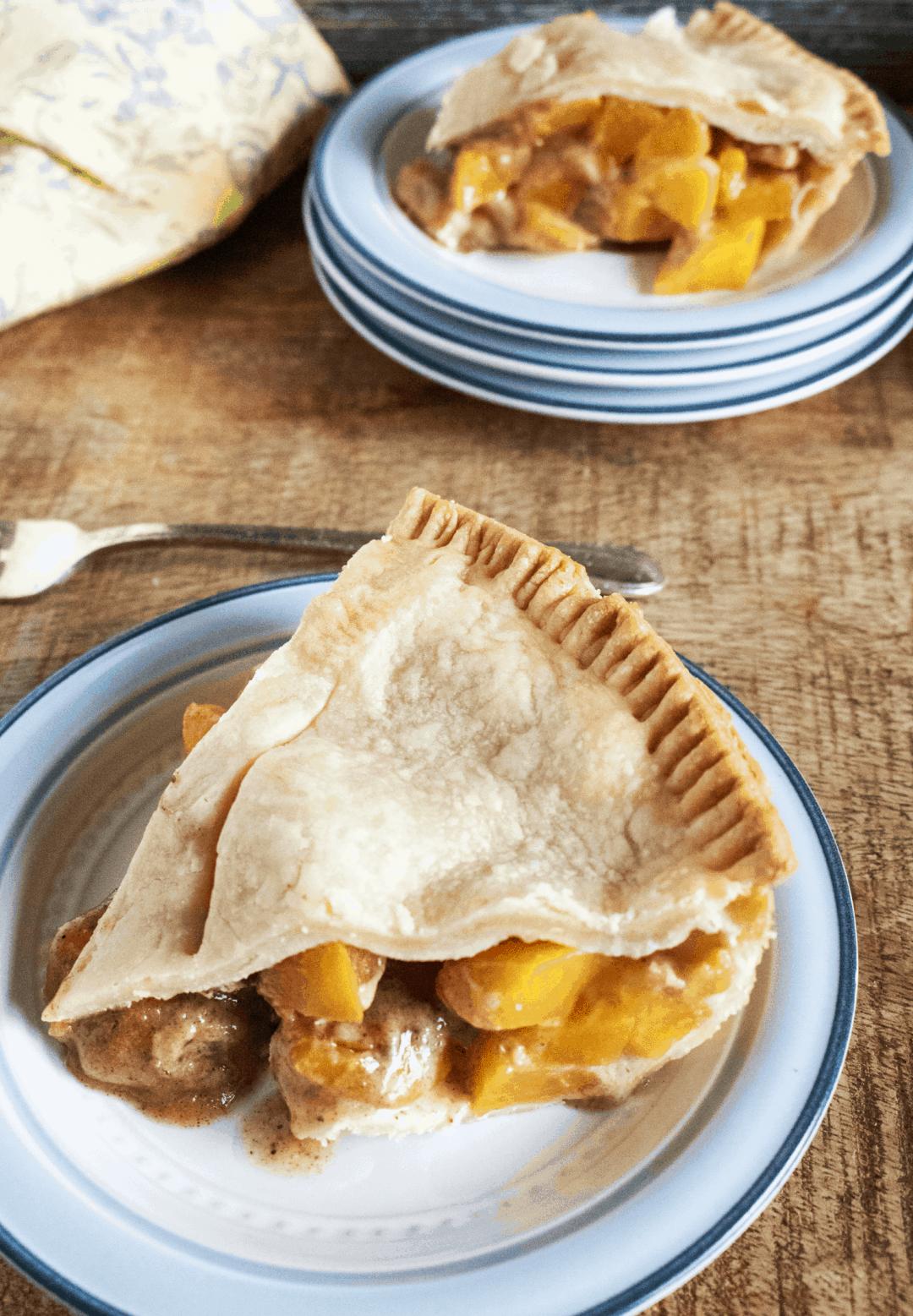 homemade peach pie on a plate