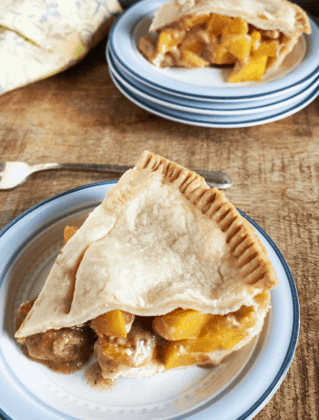 homemade peach pie on a plate