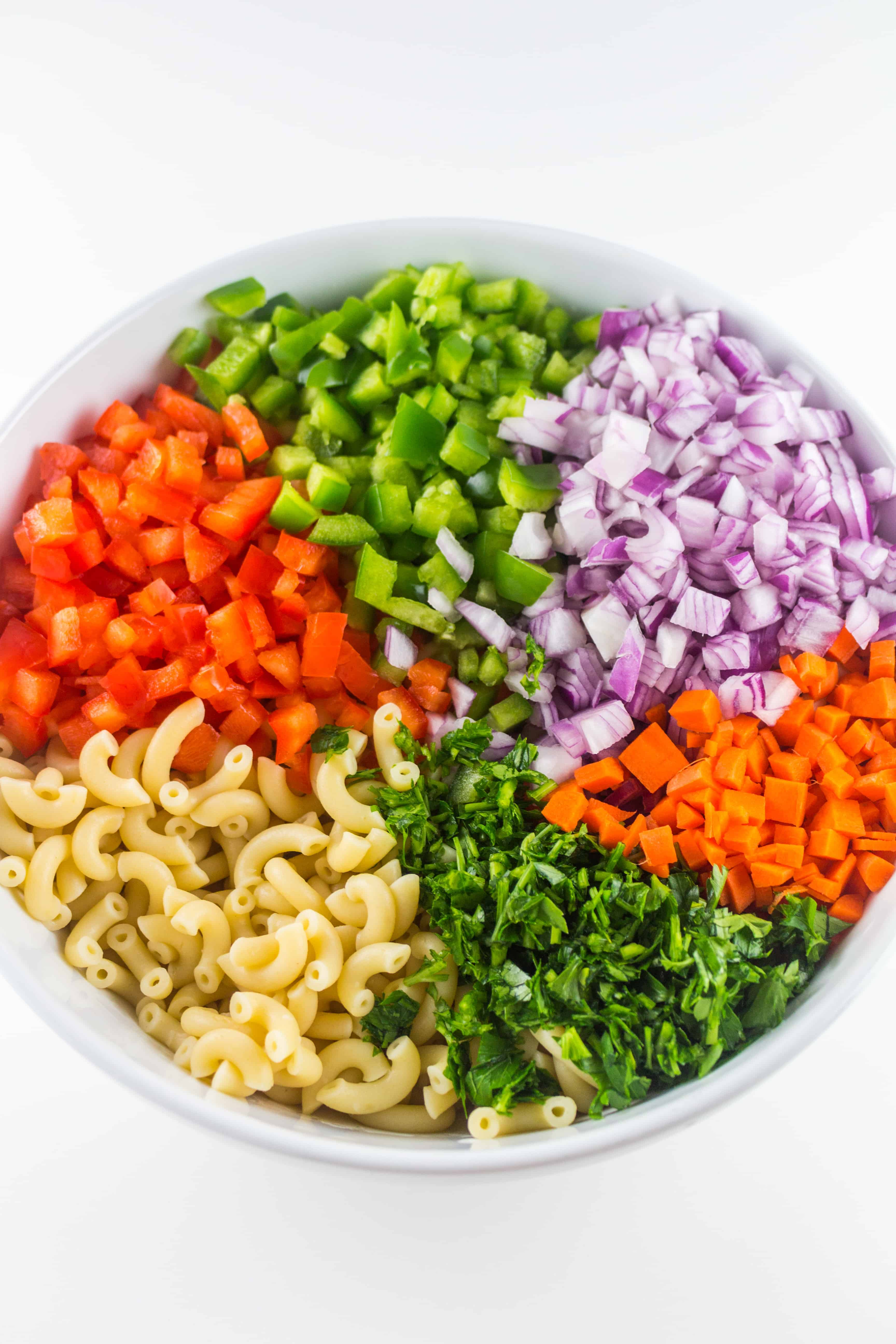 macaroni salad ingredients in a bowl