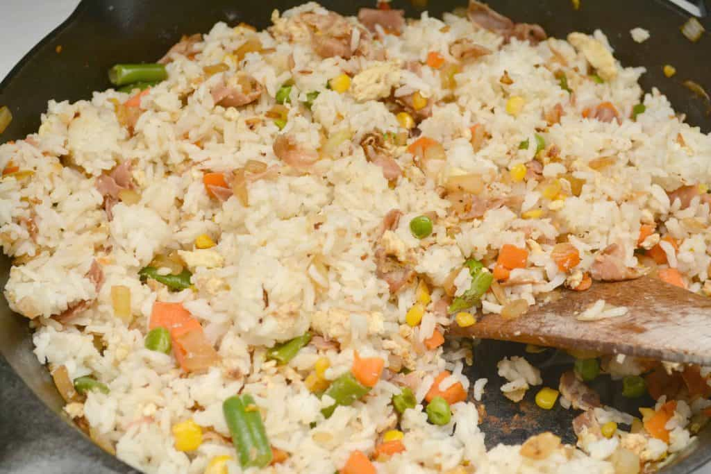rice in skillet with veggies