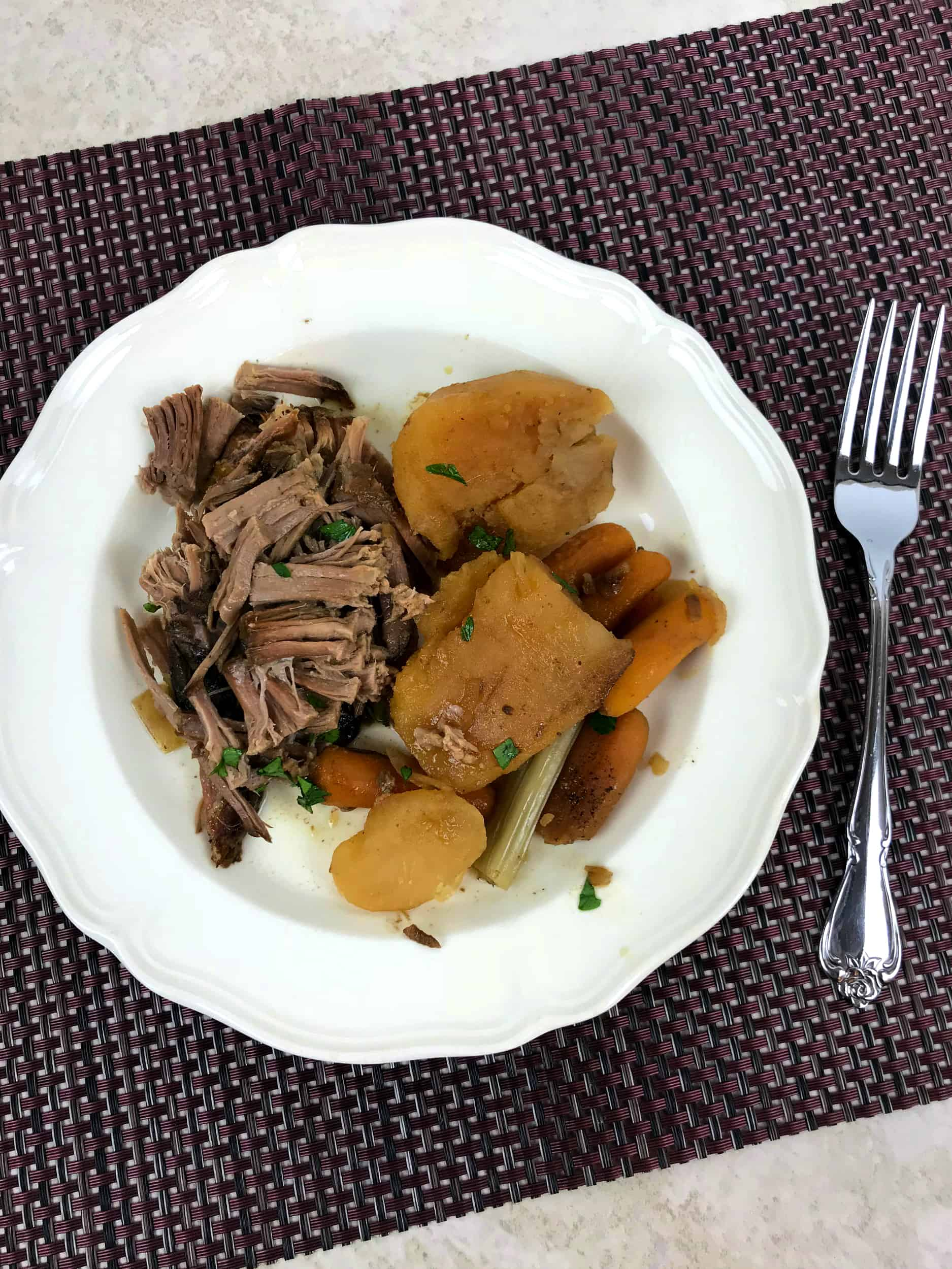 Favorite Slow Cooker Pot Roast on plate with fork by it