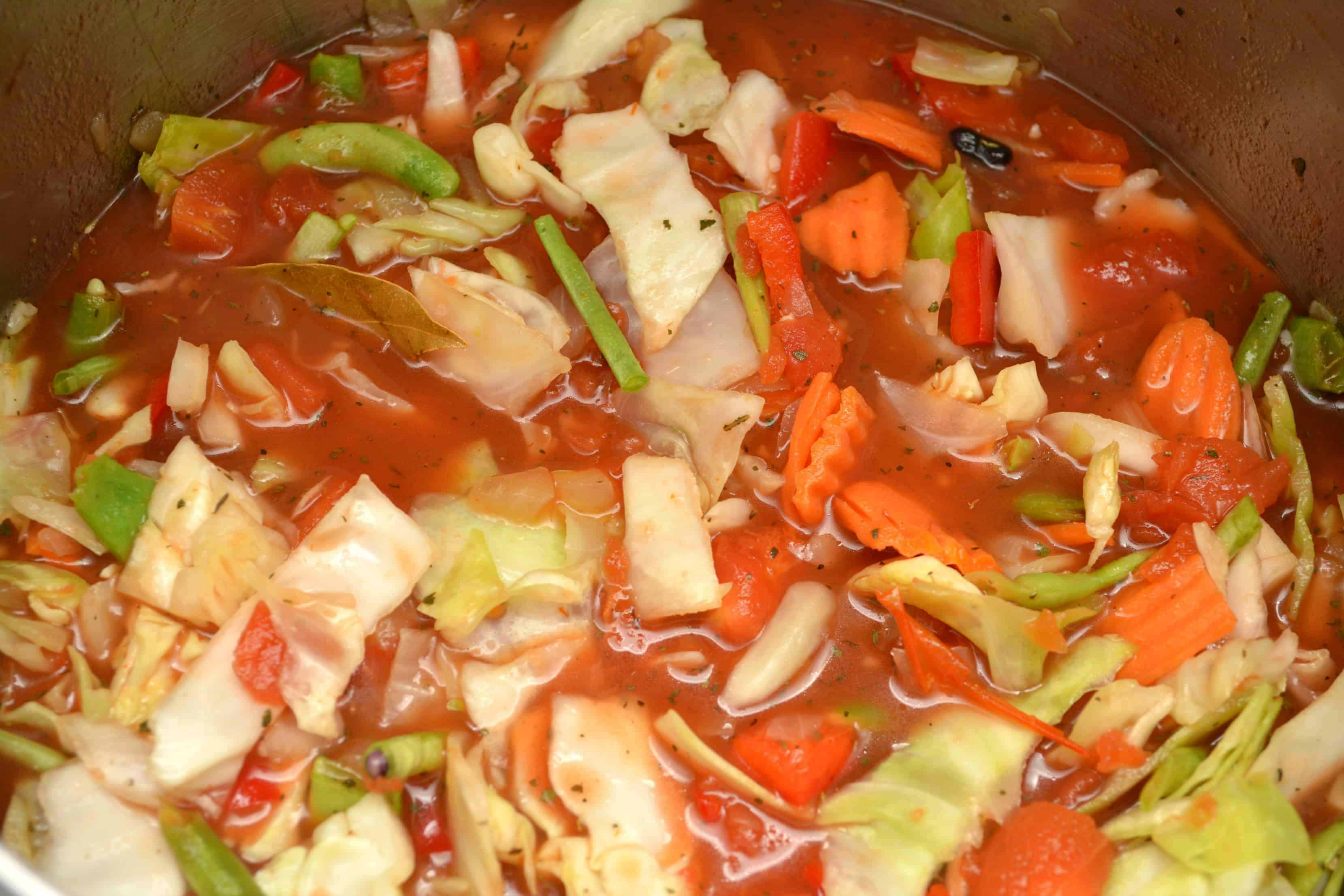 process of cabbage soup cooking in a big pot