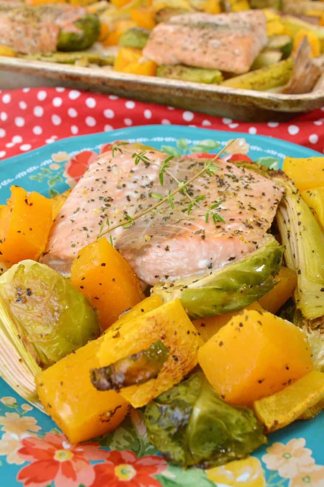 salmon with baked vegetables on a plate