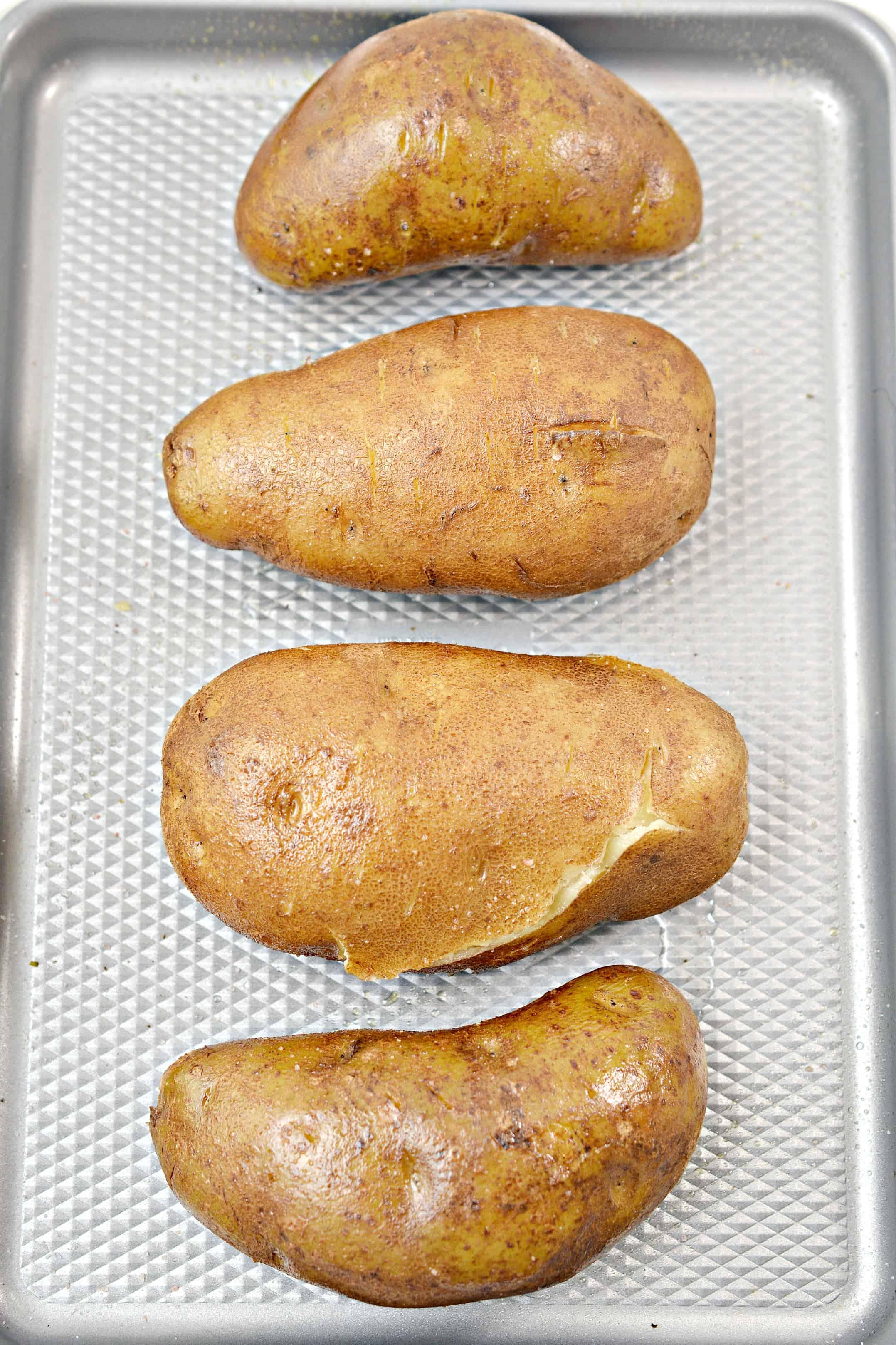 baked potatoes on a baking sheet