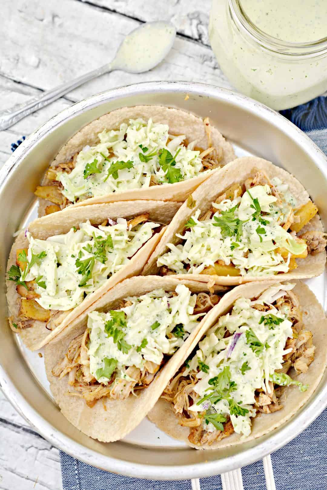 Overhead picture of prepared Instant pot chicken tacos on a silver platter