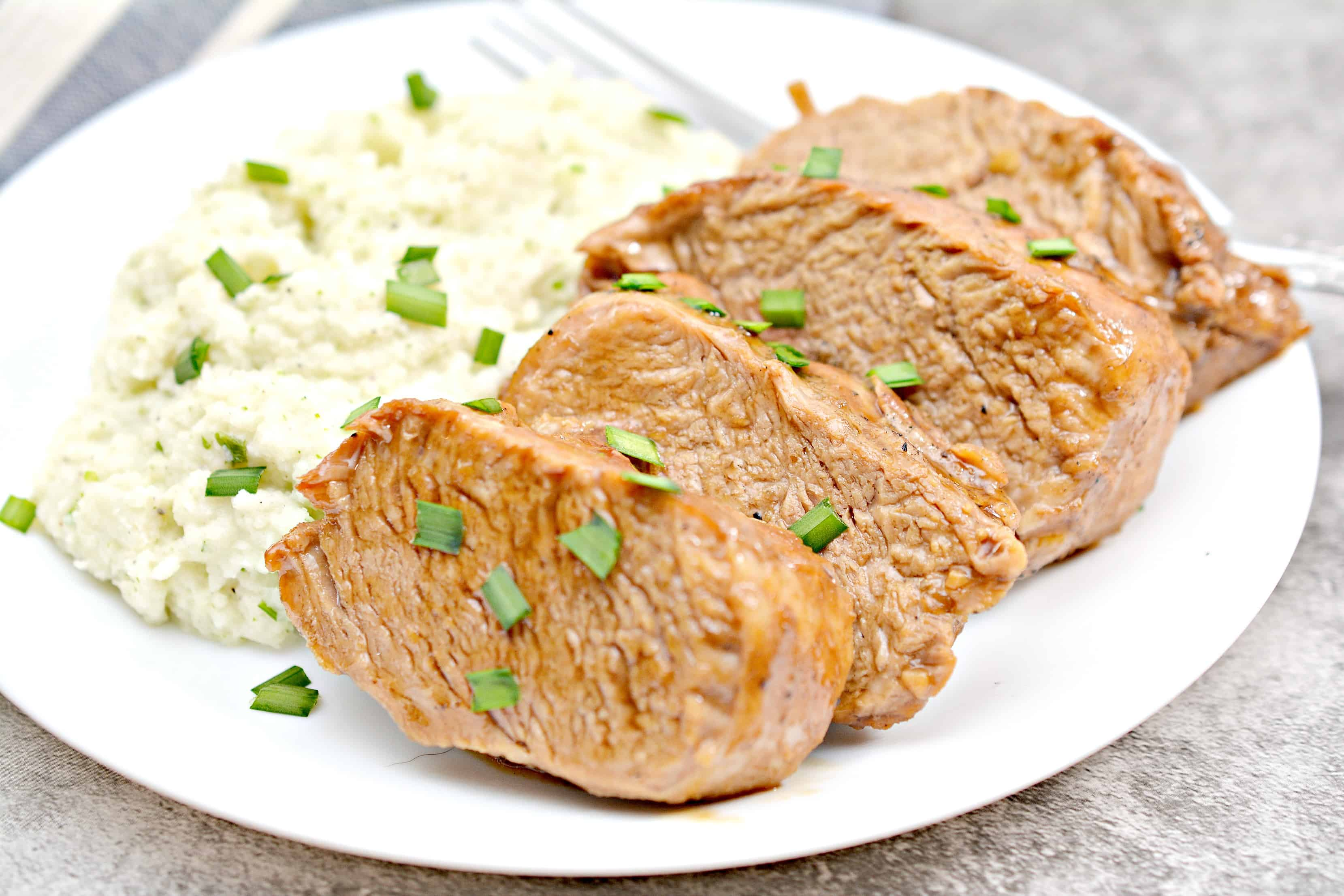 Instant Pot Pork Loin Recipe on a white plate with rice