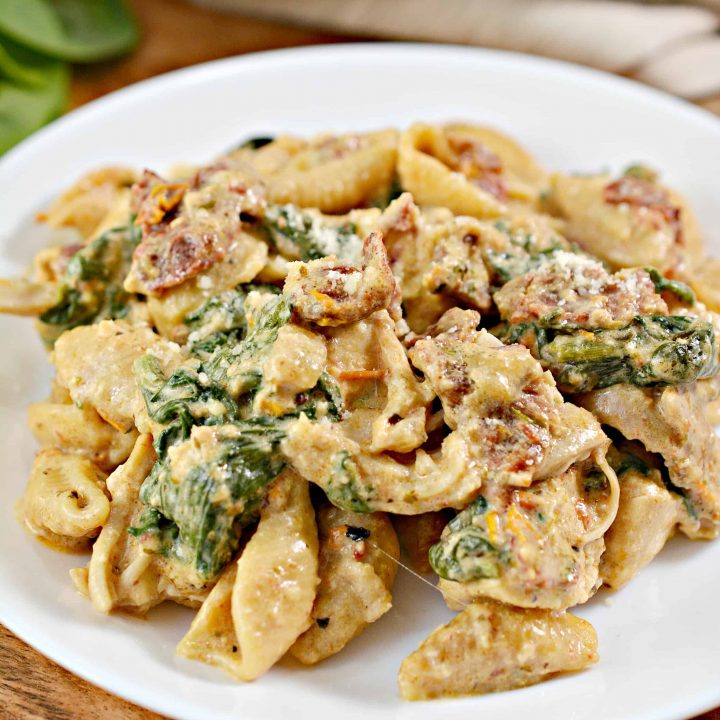 chicken tuscan pasta prepared and on a white plate for serving