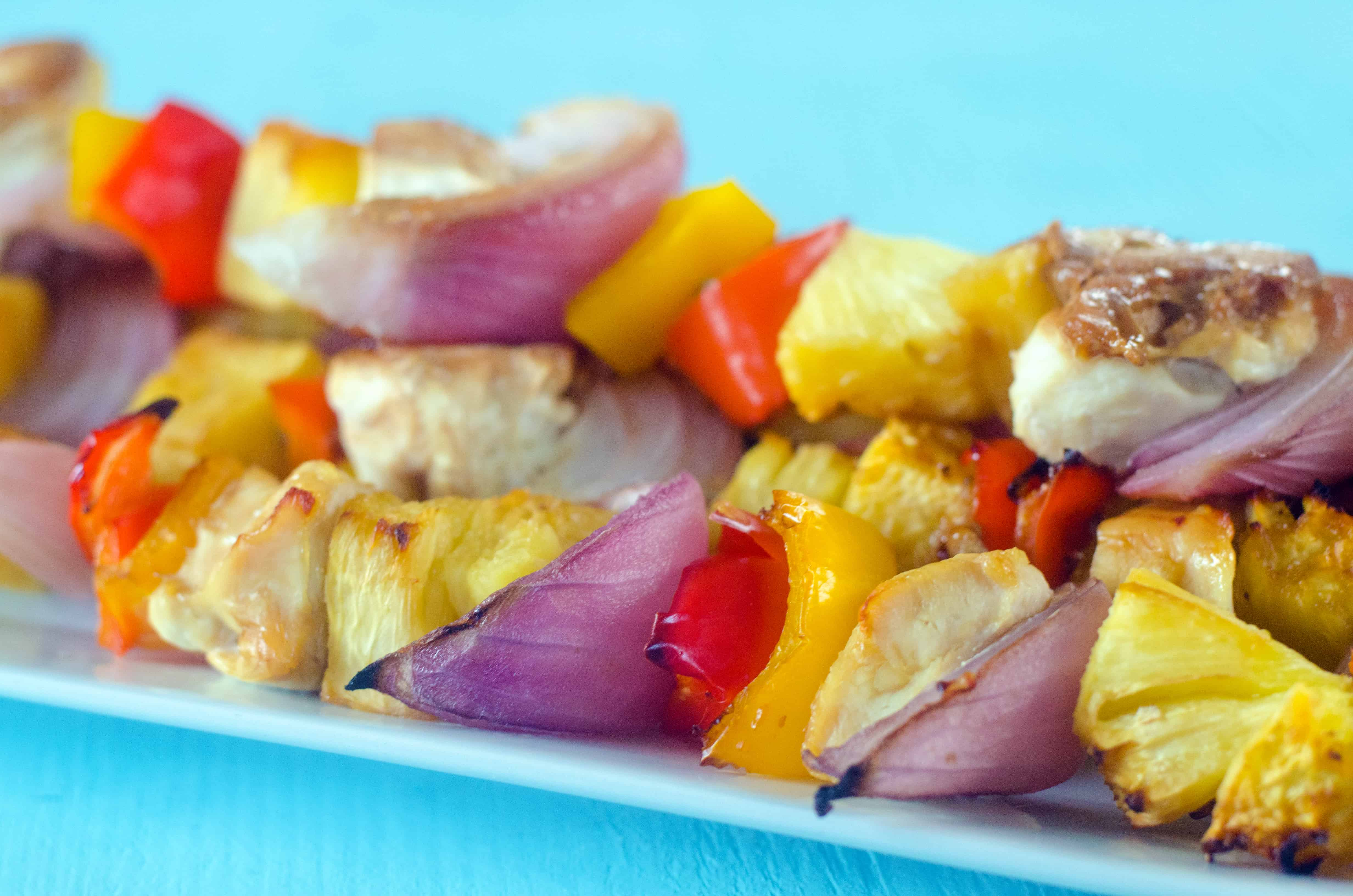 cooked chicken kabobs on a plate