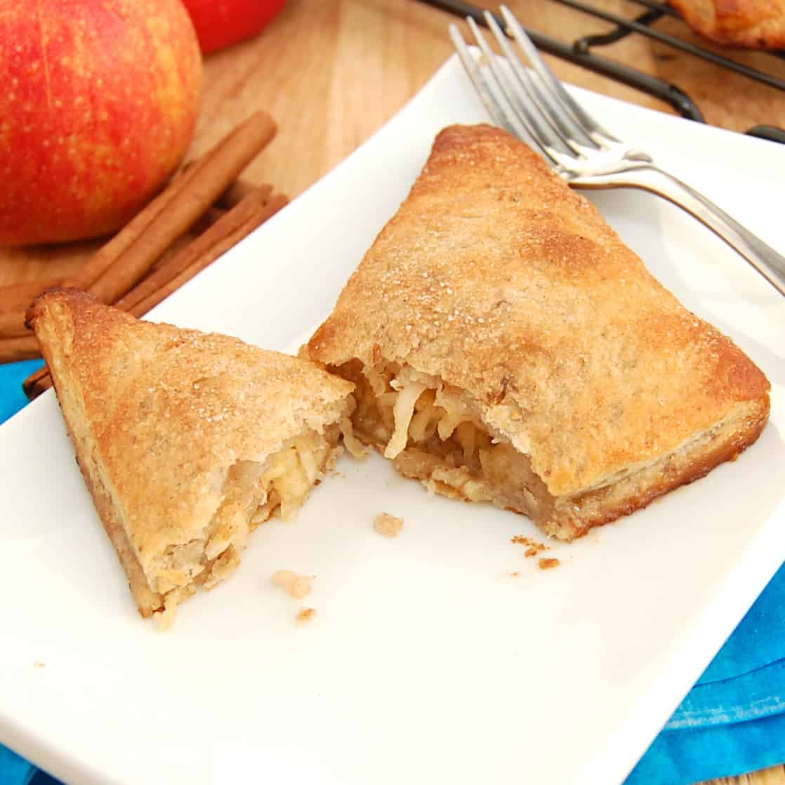 Apple turnover cut in half on plate