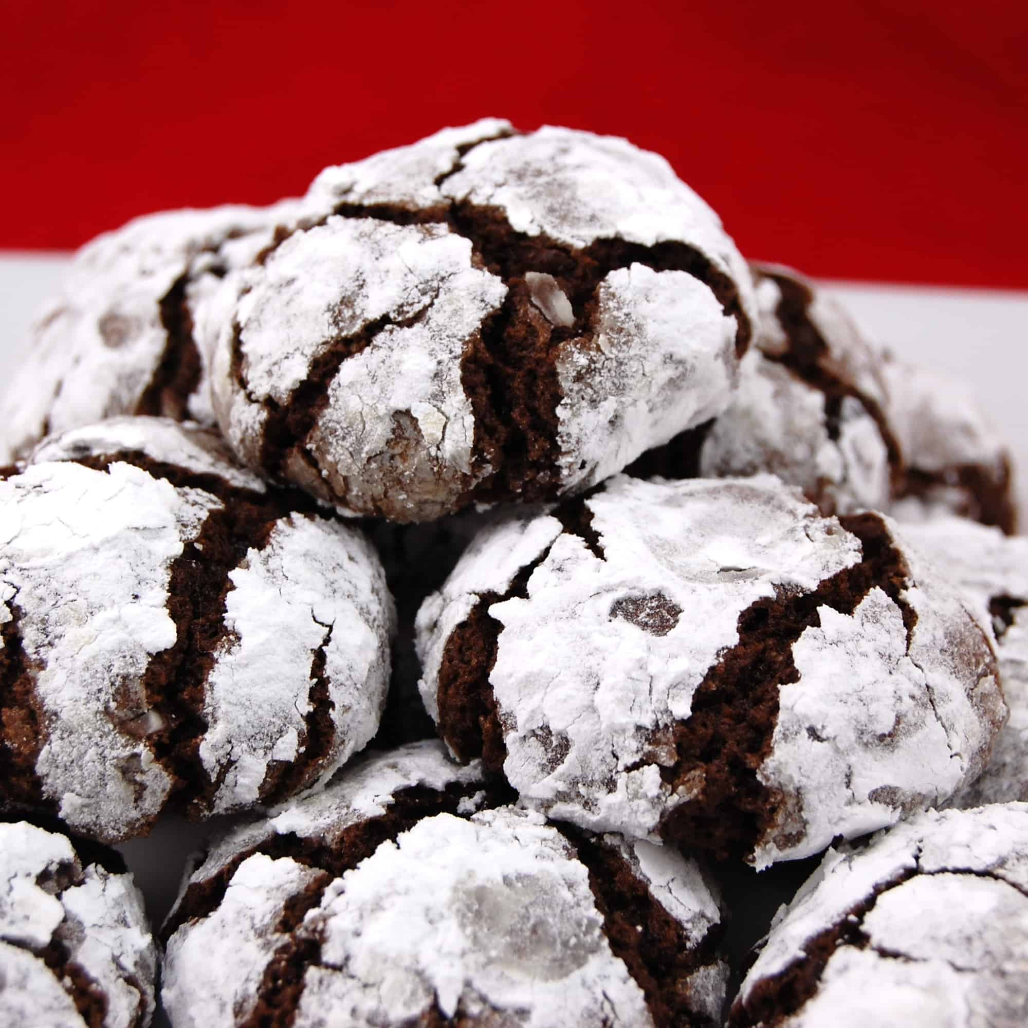 Black Forest Chocolate Crinkle Cookies with a red background