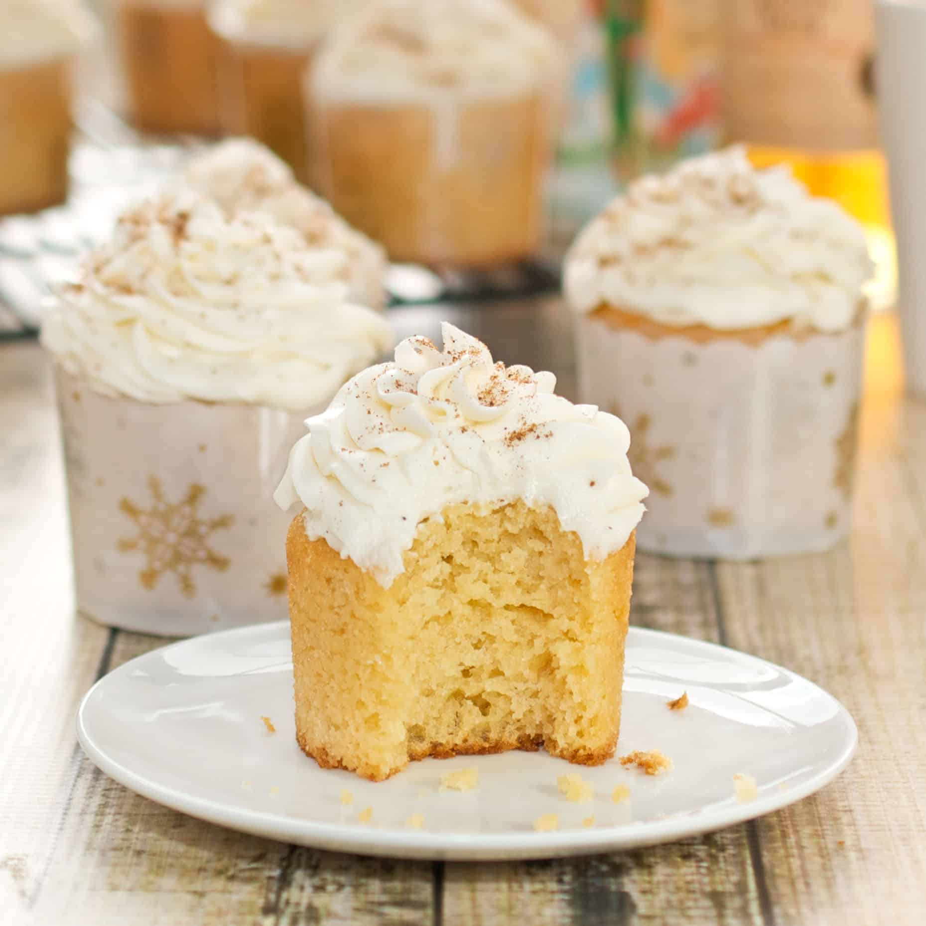 Up close picture of eggnog cupcake topped with rum infused frosting