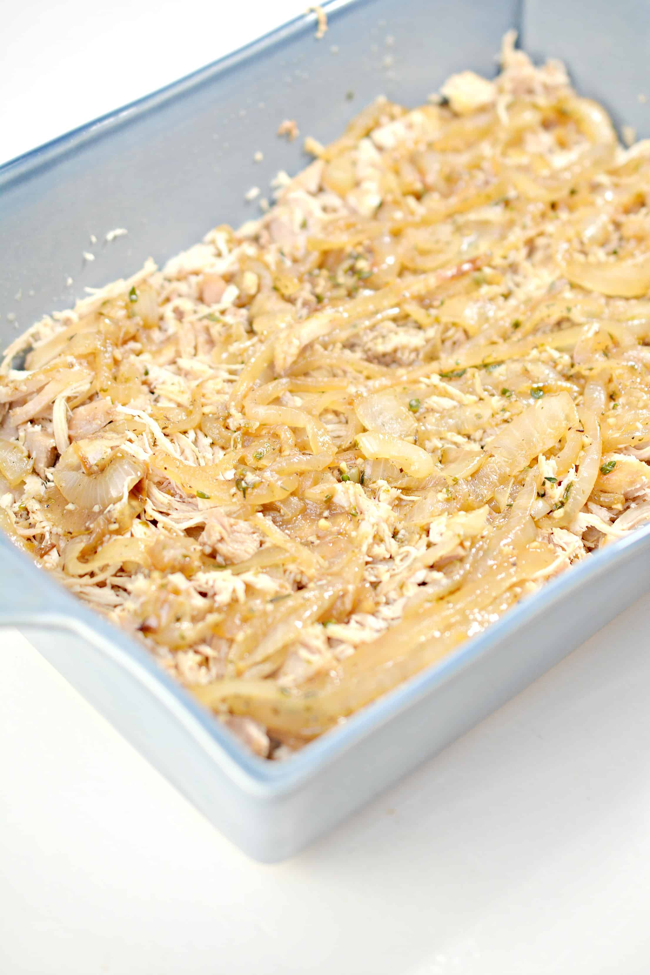 unbaked french onion chicken casserole in a pan