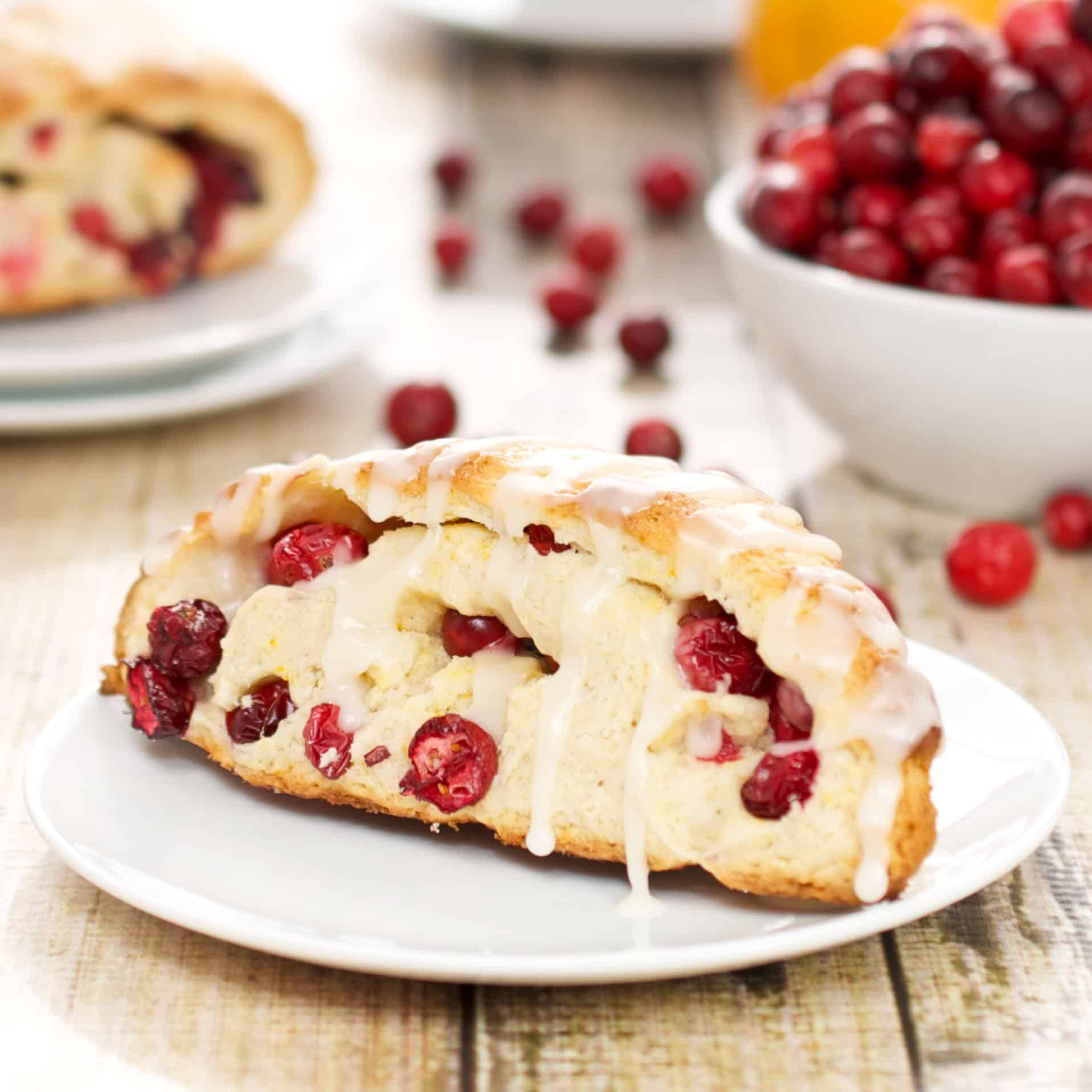 bowl with fresh cranberries and cooked cranberry orange scones