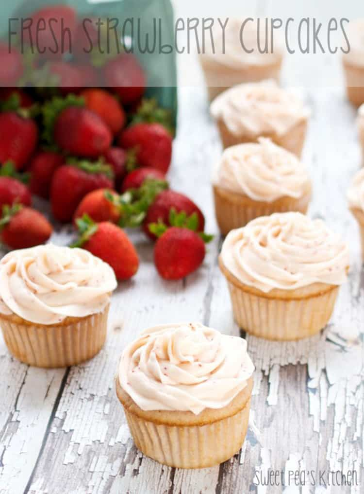 Overhead picture of fresh strawberry cupcakes with strawberry frosting on top