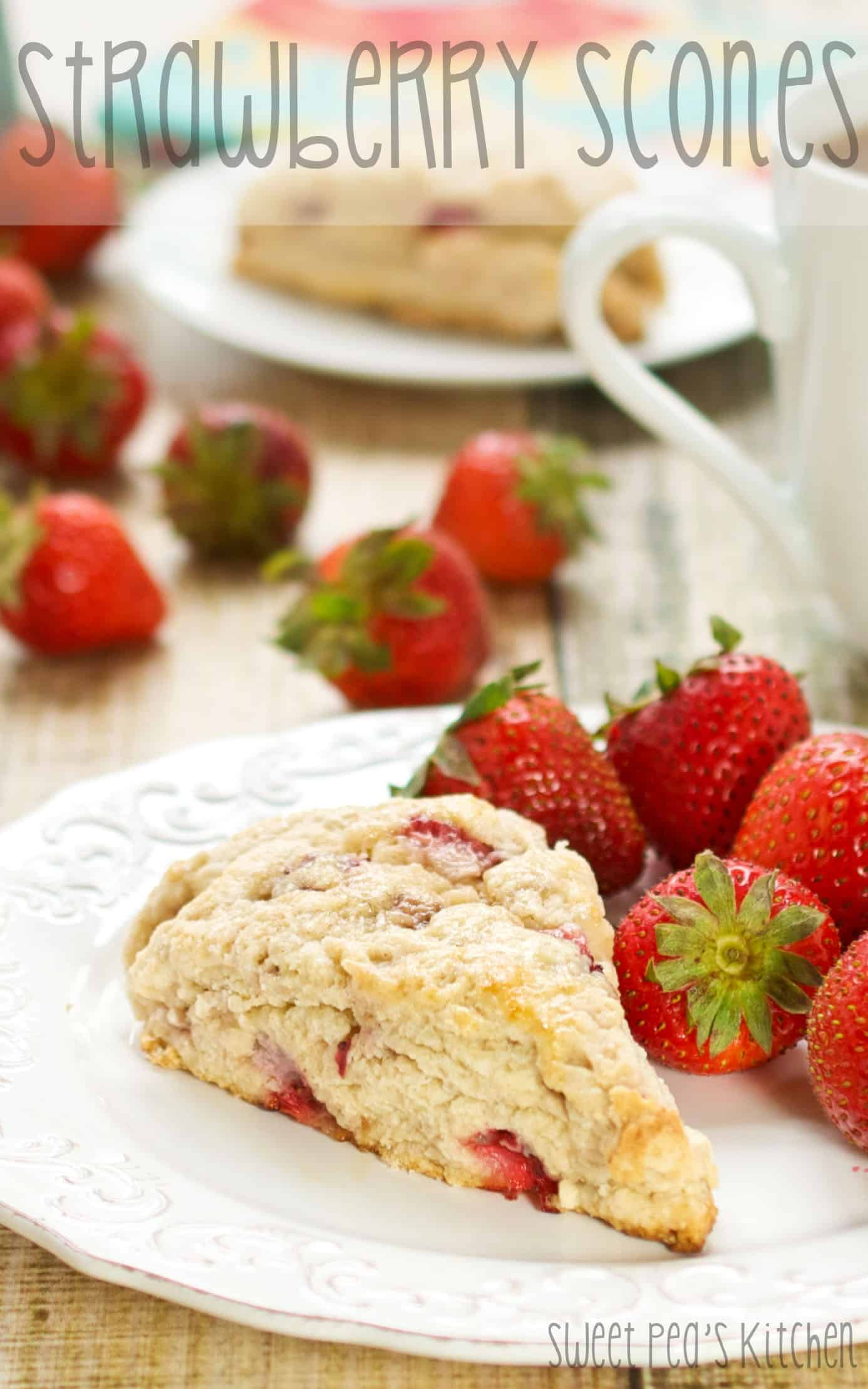 strawberry scones sitting on a white plate