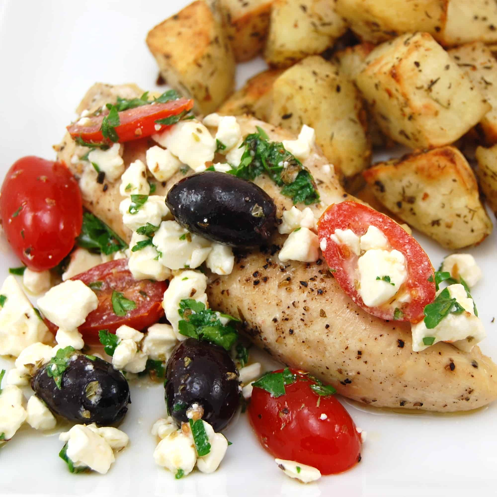 Greek chicken with feta cheese, tomatoes and olives with potatoes