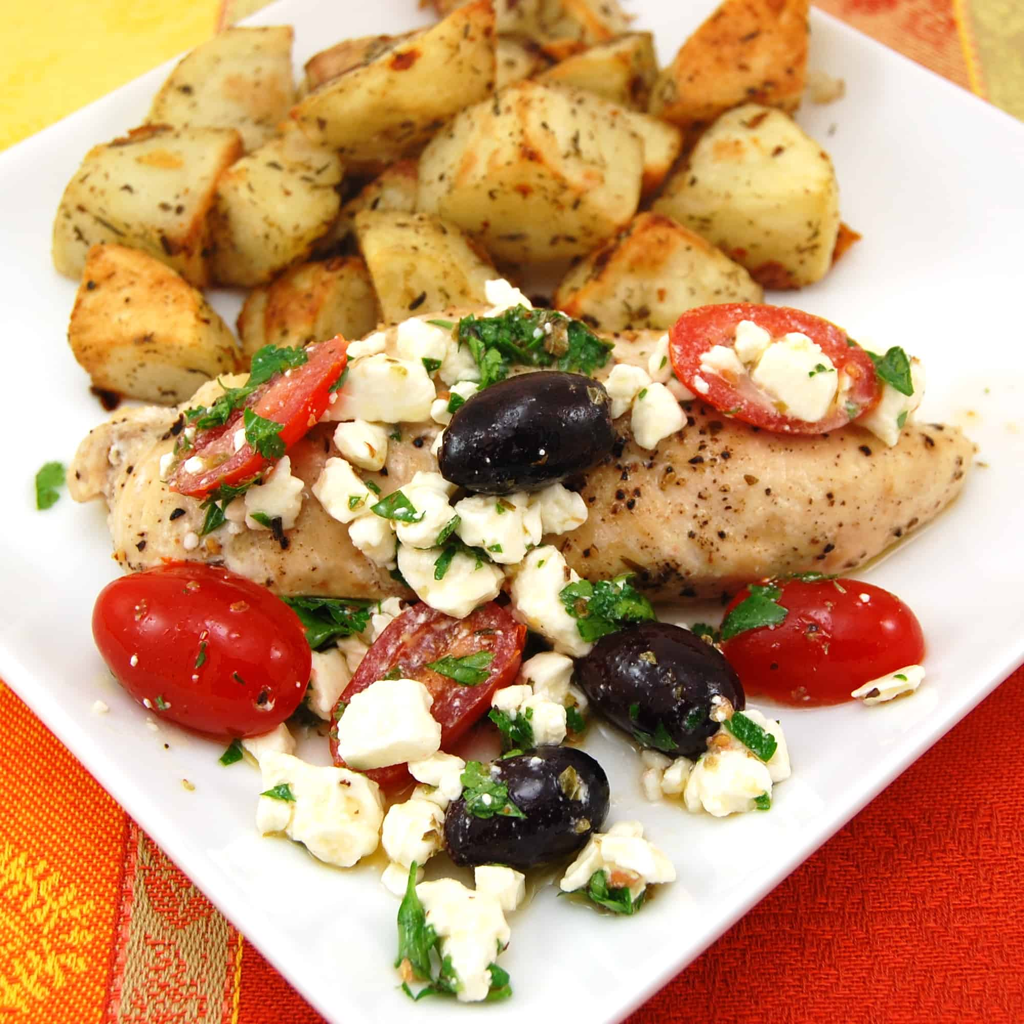 Greek chicken with potatoes, tomatoes and olives