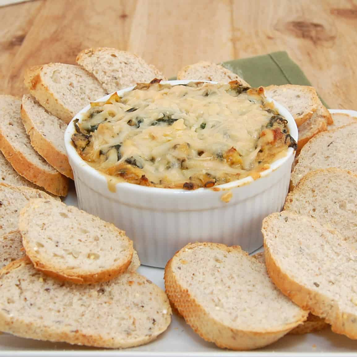 bowl of hot spinach artichoke dip