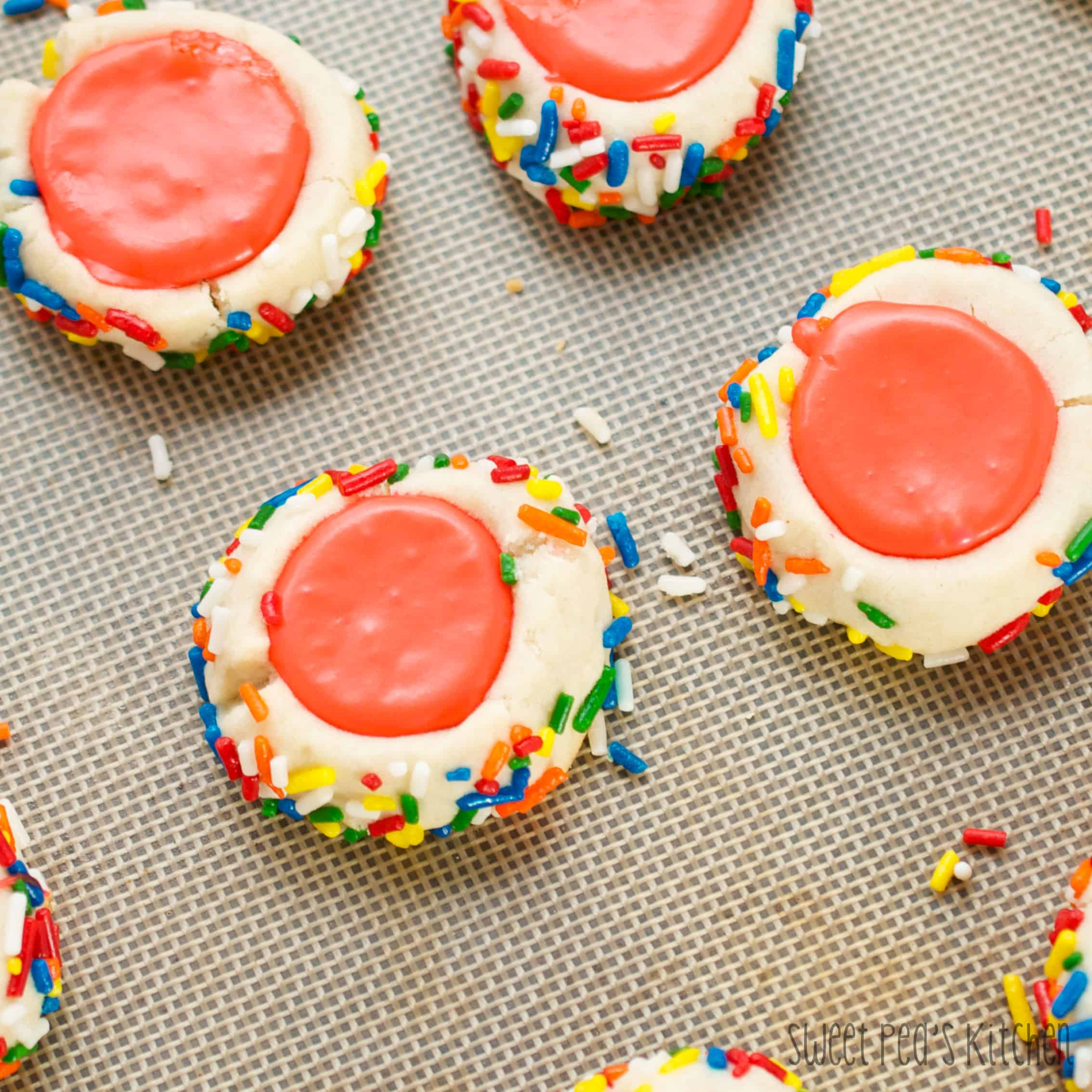 Icing Filled Thumbprint Cookie Recipe on a baking mat