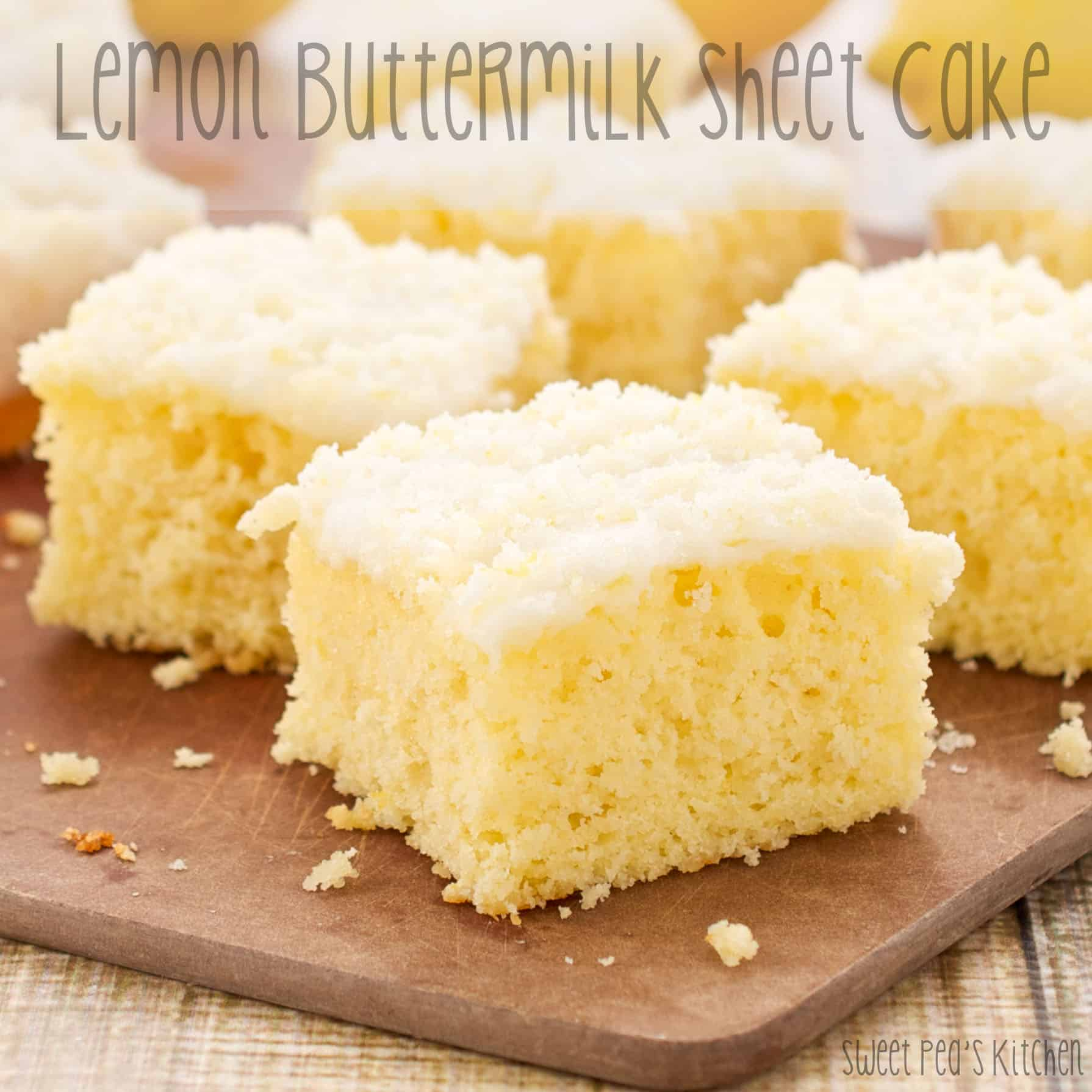 Up close picture of a moist lemon cake recipe cut into pieces on a cutting board