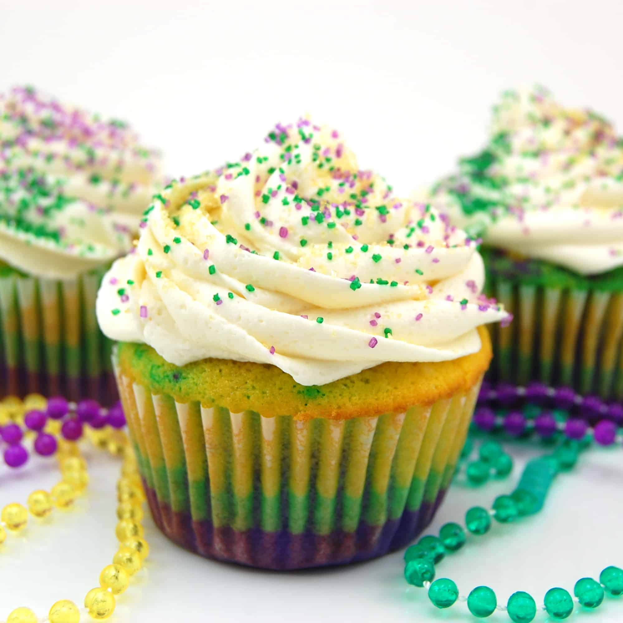 Mardi Gras cupcakes with bead necklaces