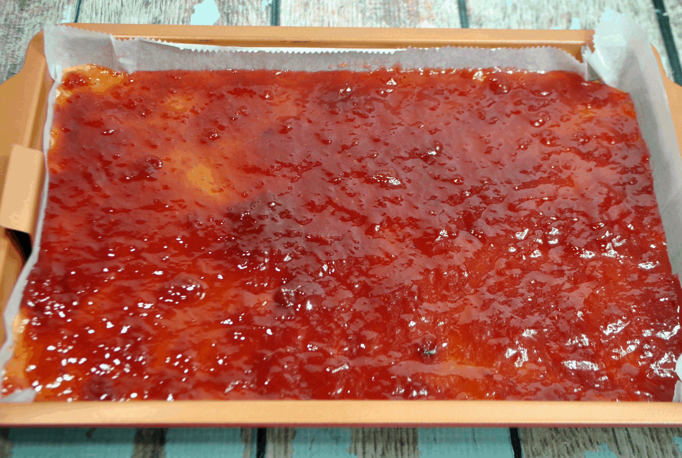 jelly on top of the peabut butter layer for the peanut butter and jelly bars