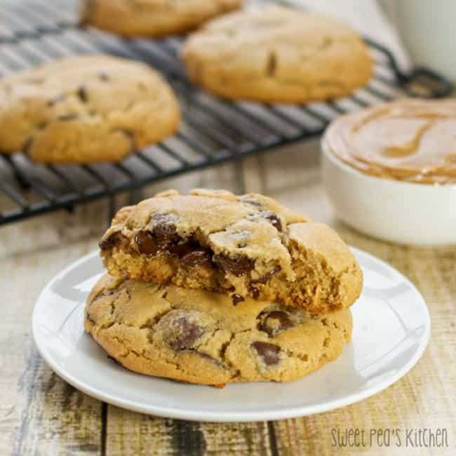 peanut butter chocolate chip cookies on a white plate and on a cooking rack