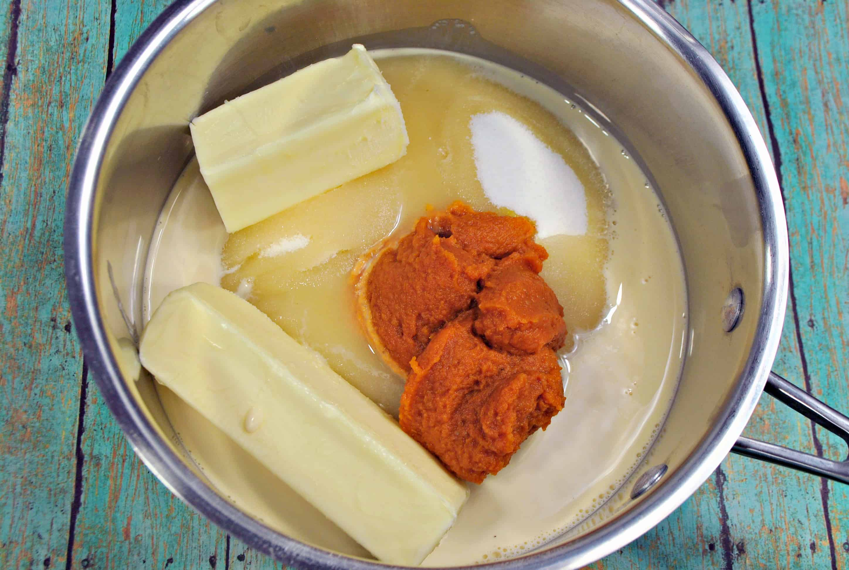 butter, pumpkin and sugar in a bowl
