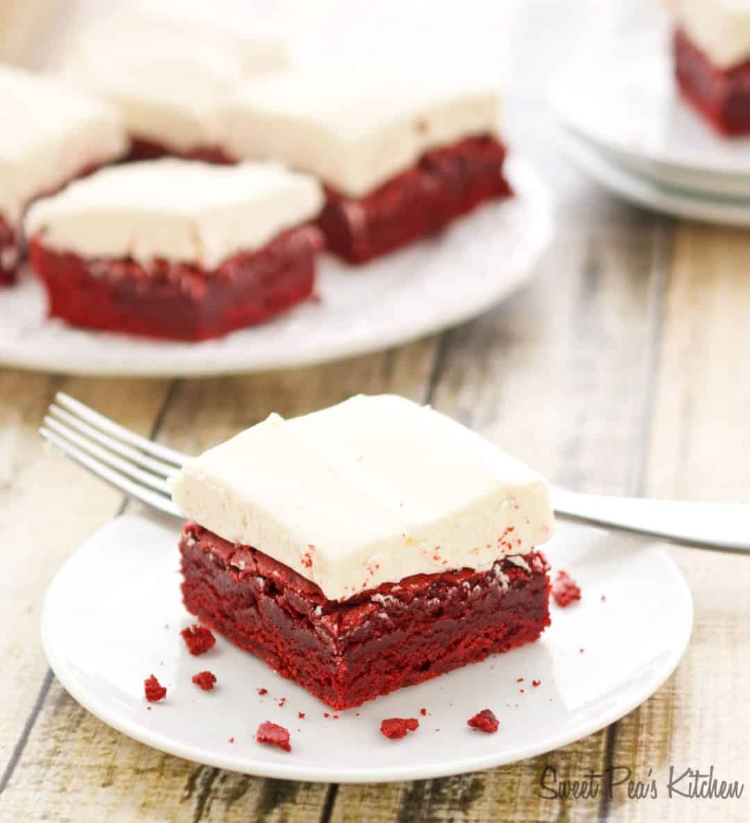 A single slice of red velvet brownies sitting on a white saucer