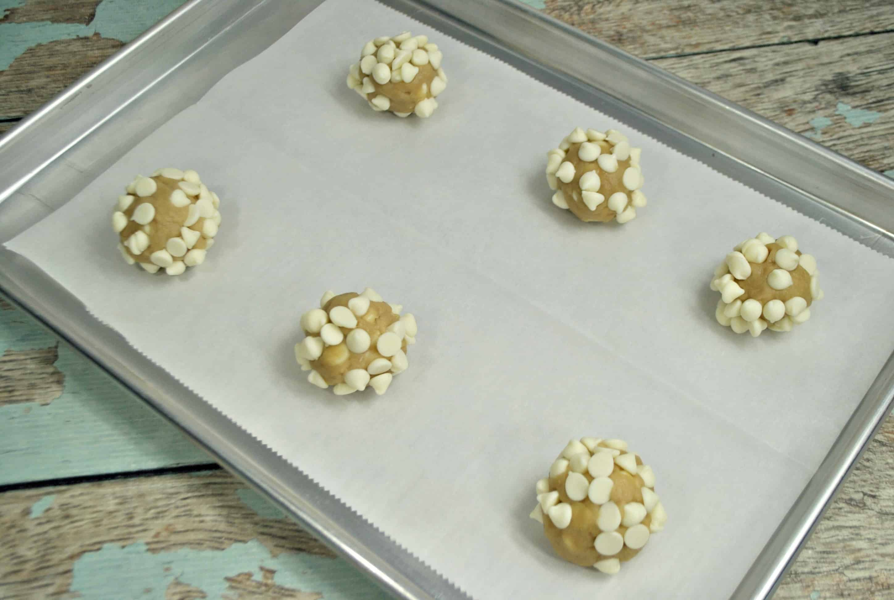 roll the dough into white chocolate chips