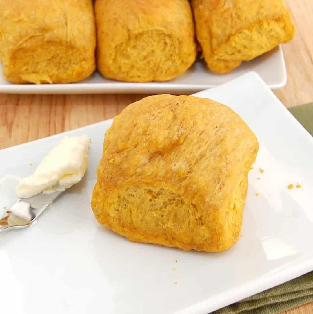 pumpkin homemade dinner roll on plate