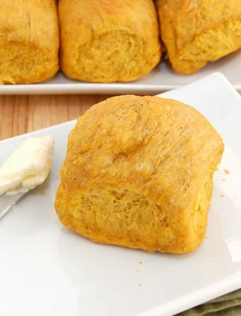 pumpkin homemade dinner roll on plate