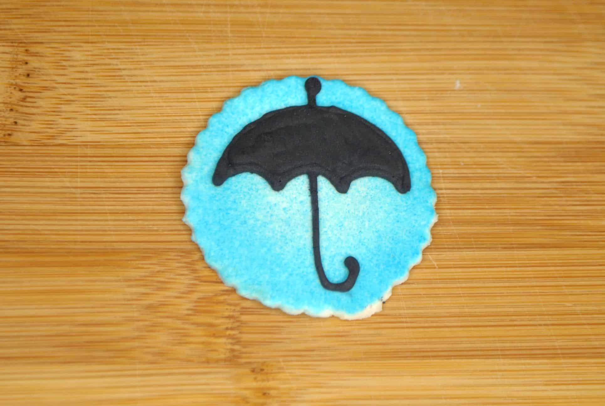 black umbrella on fondant